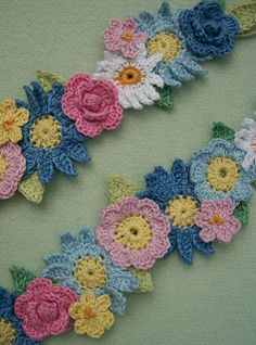 Knot Garden: Crocheted Flower Garland (blog lists books used for flower patterns)