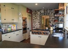 LOVE the real stone wall from kitchen into dining room!
