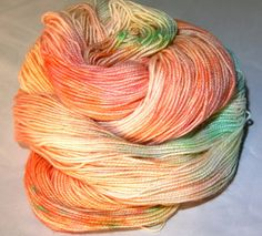 Colorway: Seashell Sparkle  Gold sparkle on a pale base with pops of turquoise, pinks and peaches - a LOVELY colorway and one of my faves!  Base: 2ply 75/20/5 Superwash Merino/Nylon/Gold Stellina 438 yards 100 grams  This hand dyed yarn was created using professional acid dyes and then heat set to lock in the bright colors. I thoroughly rinse and wash all of my yarns and roving, however it is possible that there will still be some bleeding and therefore I recommend you wash your item with…