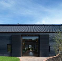 Derelict Barn Conversion into Modern Home Ancient Party Barn is located in the countryside of Kent, England. A derelict barn from the century, it was converted into a modern home by Liddicoat & Goldhill, and. Barn Conversion Exterior, Barn Conversions, Barn House Conversion, Converted Barn Homes, Black Barn, Black Wood, Agricultural Buildings, Contemporary Barn, Barn Renovation