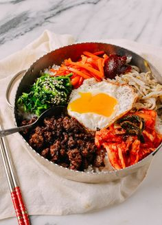 This Beef Bibimbap recipe puts a Korean classic within the grasp of any home cook. Our Beef bibimbap recipe takes about 45 minutes from start to finish. Bibimbap Bowl, Korean Bibimbap, Asian Recipes, Beef Recipes, Cooking Recipes, Healthy Recipes, Easy Korean Recipes, Asian Desserts, Fast Recipes