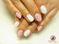 super cute neutral nails with Cosby sweater design in white