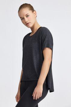 <p>This boxy fit tank from Beyond Yoga features a dropped shoulder with short sleeves. The open b...