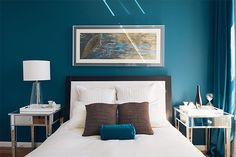 9 Smart Home Decor Tips To Revamp Your Space #refinery29  http://www.refinery29.com/spring-decor-ideas#slide11  Kim's beautiful bedroom is a wash of calming blue. The mirrored side tables, a white bedspread, and big a lampshade reflect the great sunlight. If you're going to paint your walls a bold color — especially one that's on the darker side — make sure to bring light in with neutral or bright furniture. Shop Similar: Target Mirrored Side Table, $99.99, available at Target; World Market…