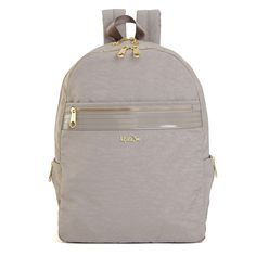 """Finished with gold hardware and patent trim, this backpack was designed with a sleek shape to go incognito for nine-to-five and after-hours. Dimensions: 11"""" x 15.5"""" x 5"""" Weight: 1.3 lbs"""