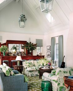 Blue/gray and green - Large bar, colorful couches and rug, lanterns, painted wicker in a pool house in LA - Ferguson & Shamamian