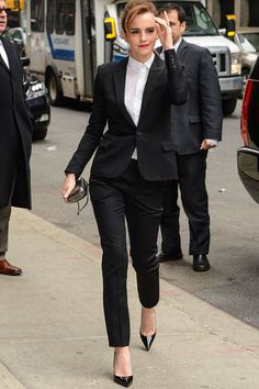 Emma Watson in a Saint Laurent suit, Christian Louboutin heels, Reese Hudson clutch, and Sabine G rings while visiting the Late Show With David Letterman in New York. See all of the actress's best looks.