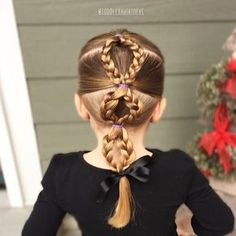 """Here is a fun twist on a regular bubble pony! I started with 3 center ponies and connected them each with 2 curved braids! This one was super easy, I finished and Viv said, """"Wow, that was really quick hair!"""" Win! This style was inspired by @nita_loves_hair!"""