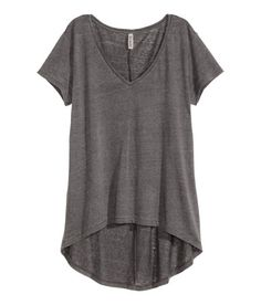 Check this out! V-neck top in sheer jersey with short sleeves and rounded hem. Longer back section. - Visit hm.com to see more.