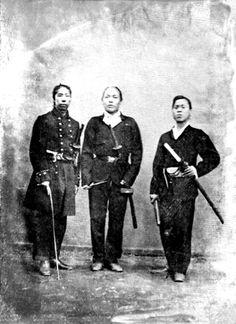 Boshin war era samurai, late Edo period. Oguri Mataichi (left) holding a muchi (whip).