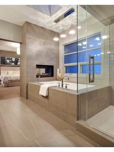 Inspirational Bathroom Design Ideas and Photos - Zillow Digs Love the two sided fireplace!
