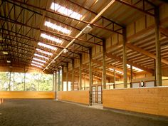 """One day I will have a big barn like this with a row of six horses (one for jumping, barrel racing, western, english, trail, and the """"buddy"""" horse).  I will then have a loft full of fresh hay, the barn would be heated, the arena would always be dragged nice and soft, and no one would bother me for hours while I played horsey."""