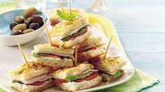 Finger sandwiches - Fresh basil, plum tomatoes and focaccia turn deli turkey into a satisfying snack with an Italian twist. Deli Sandwiches, Turkey Sandwiches, Sandwich Recipes, Finger Sandwiches, Appetizer Sandwiches, Cookie Sandwiches, Sandwich Bar, Vegan Sandwiches, Sandwich Ideas