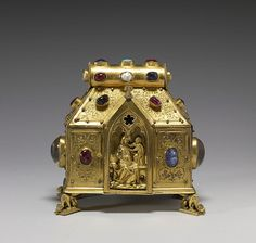 """South Germany. Reliquary of the Virgin and Saints (1 of 2 images). This type of reliquary, sometimes called bursa or """"purse-shaped,"""" originated in Germany and Austria in the 13th century. Fin XIIIe siècle. Gilt copper set with mother of pearl, rubies or spinels, rock crystal, turquoise, and unidentified gem stones. Dimensions: 13,6 × 14 × 7,8 cm.Walters Art Museum. Public Domain."""