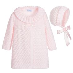 Baby girls pale pink knitted coat and bonnet by Foque. In a soft feel, this traditionally styled design has a ribbed shawl collar with button fastening and a matching bonnet with ribbon ties.