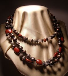 Multistrand necklace with gray pearls, hematite, quartz and red jasper. Nickel free steel closure