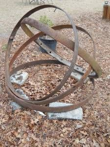 Iron Band Sculpture at Peach Festival Gardens.  Reclaimed Iron from rotted wagon wheels.  www.Facebook.com/PeachFestivalGardens
