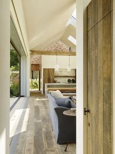 Rustic wood flooring used in the design of The Poolhouse | Rose Uniacke