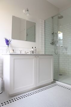 Like lots of things in this one - subway tile walls, big cupboard underneath sink, glass shower.