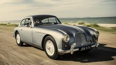 This is the 1954 Aston Martin Vantage DB 2/4 Mk I which inspired Ian Fleming to envisage the Aston Martin DB Mk III which James Bond drove in the novel Goldfinger, and subsequently became the DB5 in the movies Goldfinger and Thunderball.