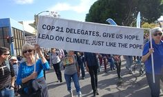 Climate activists in Oakland, California, march to send a message to world leaders preparing for the COP21 summit in PAris.