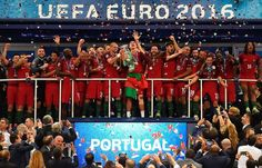 TOPSHOT - (From R) Portugal's midfielder Renato Sanches, Portugal's forward Eder, Portugal's defender Cedric Soares, Portugal's midfielder Adrien Silva, Portugal's midfielder Joao Mario, Portugal's midfielder Andre Gomes, Portugal's midfielder Joao Moutinho, Portugal's forward Cristiano Ronaldo, Portugal's defender Pepe, Portugal's forward Ricardo Quaresma, Portugal's defender Bruno Alves, Portugal's midfielder Danilo Pereira and Portugal's defender Eliseu pose with the trophy as they…