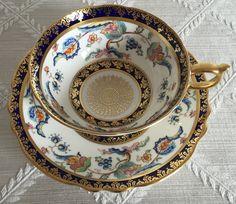 Paragon Peacock Blue Gold Double Warrant Tea Cup / Fine Bone English China / Duo Paragon Gold Gilt Handle / Vintage Tea Cup / Tea Set by ClassiqueVintique on Etsy https://www.etsy.com/listing/227230358/paragon-peacock-blue-gold-double-warrant