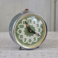 A vintage wind up Sevani Alarm Clock with distinctive style bold design on the glass face, in a stylish dark green weathered metal case. Bold Fashion, Alarm Clock, Style Bold, Metal, Vintage Clocks, Glass, Green, Armenia, Accessories