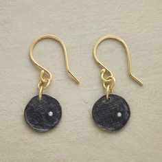 """NOCTURNE EARRINGS--Sarah McGuire's diamonds twinkle within textured sterling silver disks oxidized to deepest black. 18kt gold French wires. Handmade in USA. 7/8""""L."""