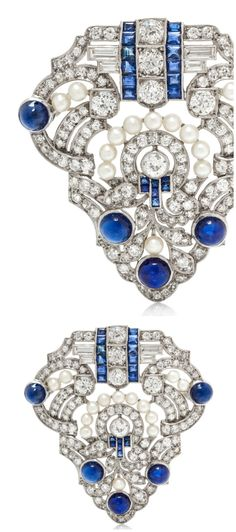 An antique Art Deco platinum, diamond, and sapphire brooch.