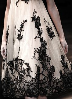 Alexander McQueen dress with black lace.