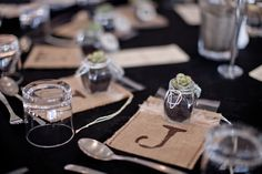 Wedding favours - handmade jute bags with personalised intials for collecting lollies from the lolly table along with a little succulent in a jar