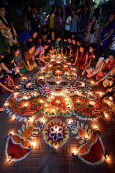 Diwali, the Hindu festival of lights – in pictures Indian girls light earthen lamps