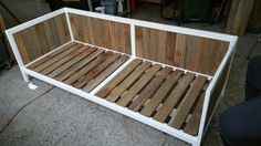 Hardwood and steel frame daybed.