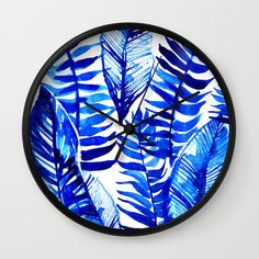 Buy Jungle Leaves & Ferns in Blue Wall Clock by lostmarketplace. Worldwide shipping available at Society6.com. Just one of millions of high quality products available.