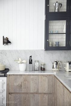 kitchen // a mix of charcoal gray, white and natural wood