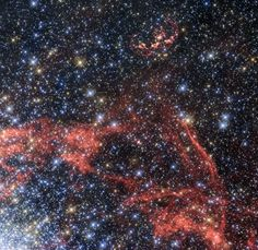 A new image taken with the Hubble Space Telescope shows the supernova remnant SNR 0509-68.7, also known as N103B. It's the wispy, elongated shell of red gas and dust near the top of the image.  Credit: ESA/Hubble/NASA