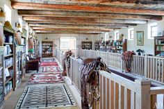 River House's upstairs galleria displays some of Fonda's Navajo rugs; the saddle in the foreground belonged to the actress Greer Garson, a onetime owner of the ranch.