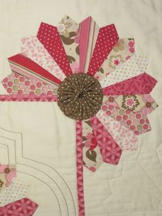Delightful Dresden Appliques- Love that she used a pin-wheel as her center. Very cute idea. Adds dimension.