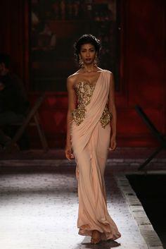 Monisha Jaising at India Couture Week 2014. Peplum corset top with draped sari