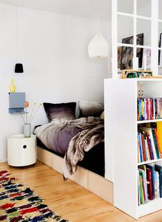 """Idea for """"Room Divider"""" using bookshelf . things every studio apartment needs Apartment Needs, Studio Apartment, Apartment Therapy, Deco Studio, Apartment Furniture, Furniture Cleaning, Bedroom Apartment, Small Space Living, Living Area"""