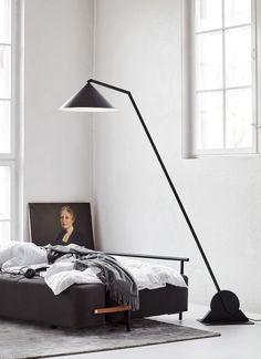 Johan Lindsten's matt-black lamps that can be adjusted using rotating gears.