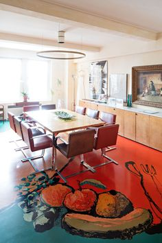 Shuman's original dining table and Mies van der Rohe chairs were left untouched. The painting on the wall to the right by was in Shuman's grandparent's house in Canada. The ceiling light fixture over the dining table is by Edison Price.
