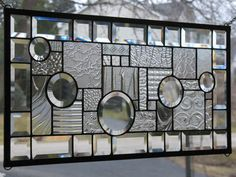 Deb, this is another cool clear one I saw.  Stufdy In Clears Stained Glass Window Panel by loveofstainedglass, $110.00
