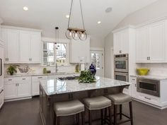 Absolutely stunning upgraded new construction kitchen. White custom cabinets, granite and brand new appliances. Have to save this for when I remodel the kitchen!