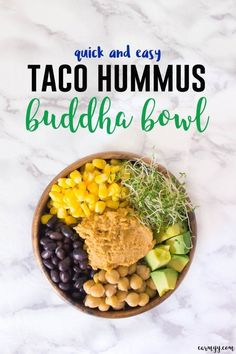 This taco hummus buddha bowl is easy to put together and is jammed packed with healthy ingredients: heaps of corn, beans, alfalfa sprouts, avocado, chickpeas, and hummus served over quinoa.