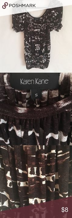 Karen Kane blouse Size small. It's a sheer material. Very beautiful with a black or brown shirt underneath Karen Kane Tops Blouses