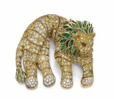 A Colored Diamond, Diamond and Emerald Lion Shoulder Brooch, by René Boivin
