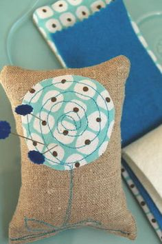 Inspiration to make some pin cushions like this. Little burlap pillows