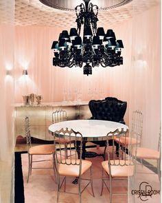 Gorgeous Paris interiors! Pink and black! I could totally do this black chandelier!  In any case, the chandelier is imperative for your parisienne salon! This is one item you just cannot do without! Every parisienne salon must have at least one, and the bigger, the more elaborate, the more elegant, the better! This is a key item! Your guests will take note of this more than any other item! So, don't hold back!